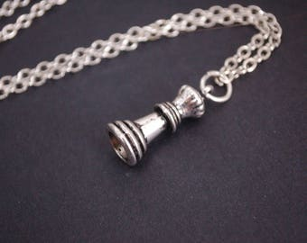 silver tone chess piece necklace