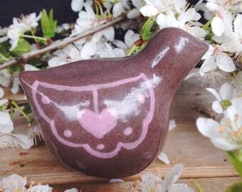 Little ceramic bird sculpture