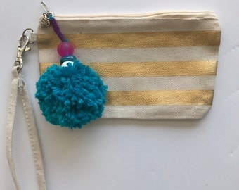 Gold Stripe wristlet with pom pom accent