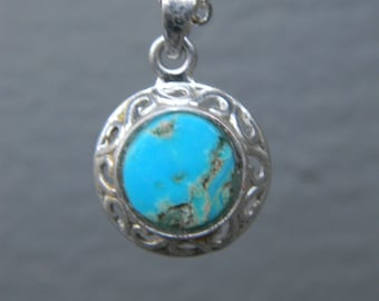 Genuine hand-cut Turquoise gemstone pendant necklace with a silver plated setting and chain