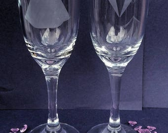 Bride and groom etched champagne glasses