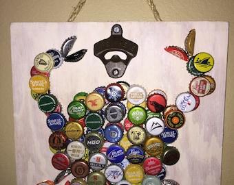 Crab wall art bottle opener made of beer bottle caps.