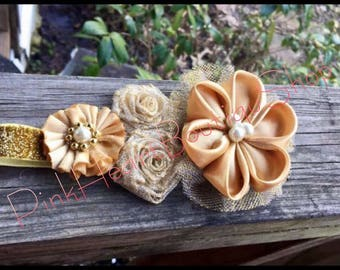 Handmade Fabric Flowers Headbands! Very unique perfect for any special occasion. From baby's to toddlers.