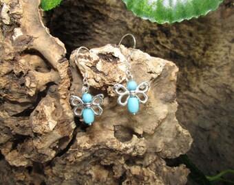 Silver drop earrings with butterflies.