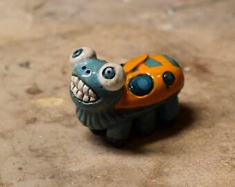 Blue and Orange Garden Bug