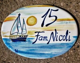 House number oval ceramic family header