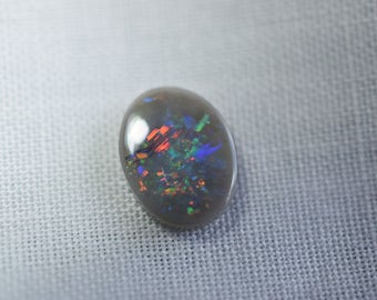 Opal #69 solid 0.63 ct multi colour speckles