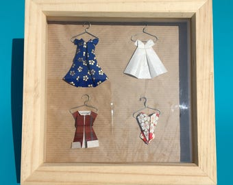 Origami Box frame with dresses on hangers