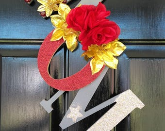 A beautiful door or wall hanger with MOM in gray, red and gold.