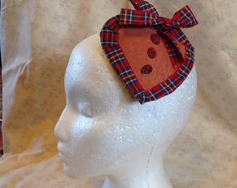 Soft brown leather heart shaped hair decoration with tartan ribbon.
