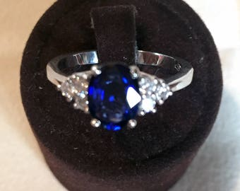 Natural oval cut Sapphire ring and six round brilliant G color purity side diamonds