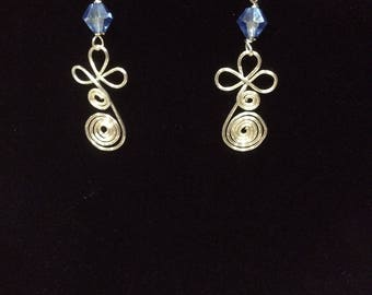 Double spiral wire wrapped earrings with light blue glass bead
