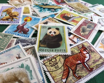 Vintage postage stamps (set of 50+)- topical collection- various animals- off paper