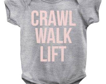 Crawl, Walk, Lift Baby Onesie