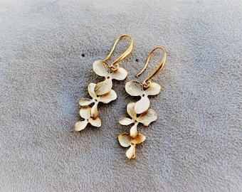 Golden handmade orchids cascade earrings