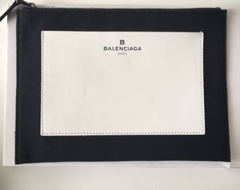 clutch Balenciaga in leather and canvas