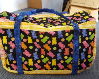 Pink and yellow striped Gummy bear duffle-sized diaper bag.