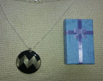 Vintage black and silver pendant.
