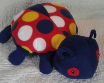 Stuffed plush ladybug.  Huggable. Could be a pillow.