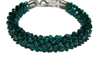 Kumihimo beaded bracelet made with Teal color crystal beads