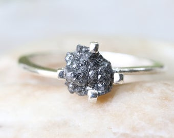 Rough diamond engagement ring in sterling silver band and traditional four prong setting