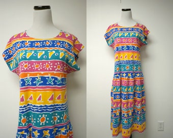 Komar . 80s summer prints . poly cotton . knit dress . loose fit . small . made in USA