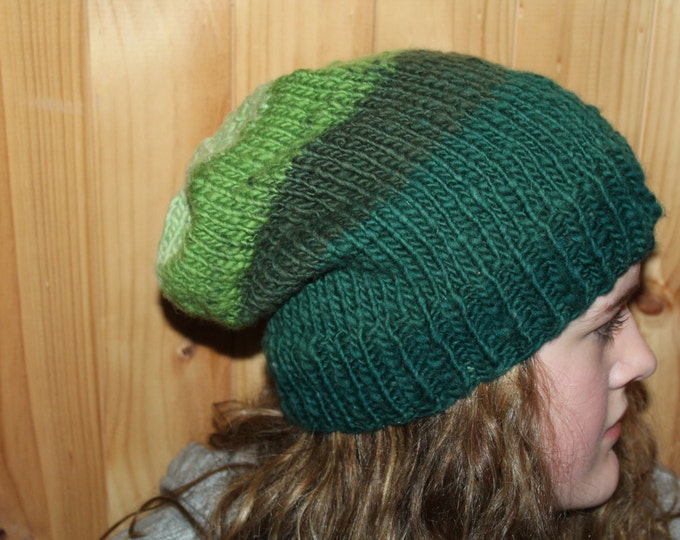 Hand Knit Merino Wool hat. Slouchy Hat.  Super warm and soft.  One size fits most adults.
