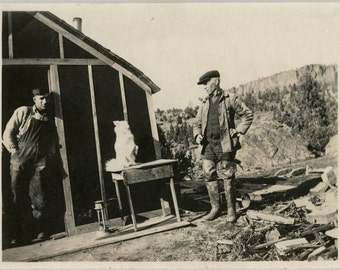 vintage snapshot photo 1920 Men Chopping Wood Entertained White Schipperke Dog Stands Table