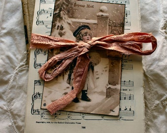 Hymnal Paper Packet with collage photo tied in sari ribbon