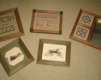 Five framed cross stitch items