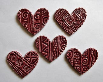 5 embossed plum colored heart shaped ceramic mosaic tiles