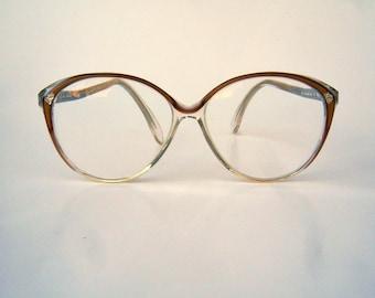 Vintage Elizabeth Arden eyeglasses / 80s eyeglasses / gold sparkle trim / large round clear frames