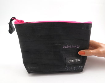Recycled bicycle inner tube cosmetic pouch for men and woman, container, bag, with pink zipper.
