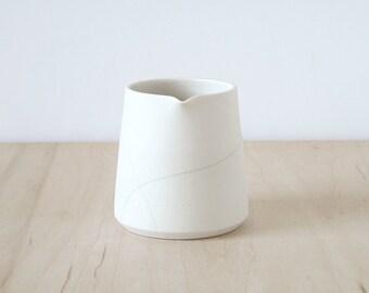 Mishima porcelain creamer.