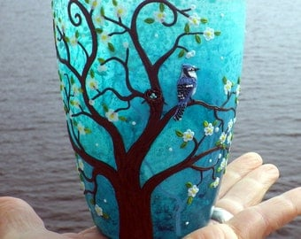 Mother Bluejay and Nest with Eggs sits in a Spring Blossom Tree Sculpted with Polymer Clay onto a Recycled Glass Candle Holder in Turquoise
