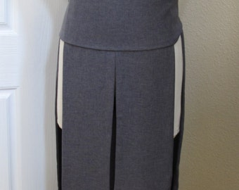 Gray sleeveless hooded tunic tabard vest with a sash.