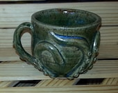 Small green brown octomug, the Octopus mug!