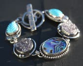 RESERVED LAYAWAY for Connie oOo carved turquoise, amethyst druzy, abalone shell, and sterling silver metalwork link bracelet