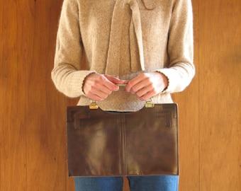 1970s brown leather handbag with metal handles