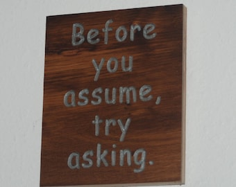 Before you assume, try asking. - Wood carved plaque.   17055