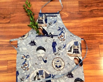 LOST AT SEA blue sailor style apron with sexy mermaid, dapper sea captain, and full sails ahead