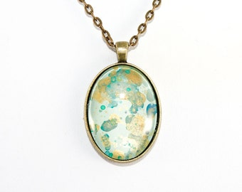 Splatter Painting Pendant - Abstract Art Brass Oval Necklace - Caribbean Waters Colorway: Aqua, gold, teal