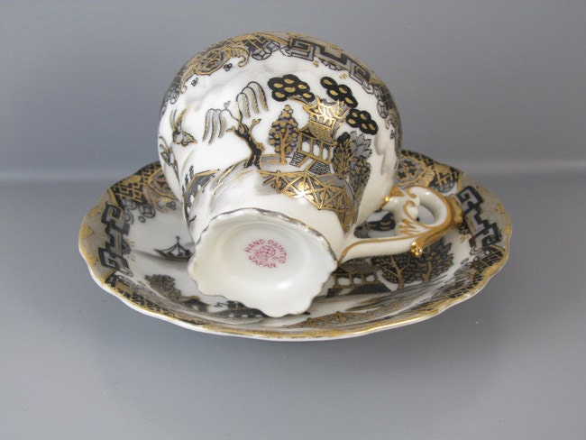 Vintage hand painted black gold Japan demitasse cup and saucer / porcelain / china / bone china / tea / coffee