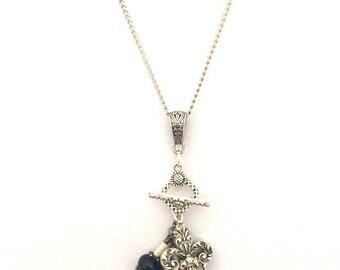 Changeable pendant with lampwork bead.