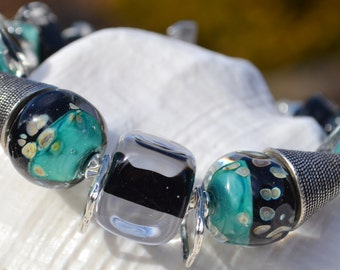 Reserve for Judy-REFLECTIONS-Handmade Lampwork and Sterling Silver Bracelet