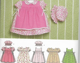 Simpliicity 4709 sewing pattern, Baby Dress, Pinafore, Pantaloons,Panties, Hat.  Size xxs - L  Uncut Pattern