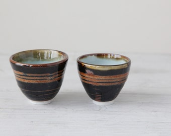 Wheel Thrown cup or small bowl set with robin's egg blue interior and brown stripes