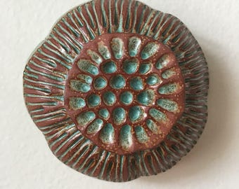 One Turquoise Green and Red Clay Flower Pod Wall Art