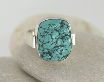 Textured turquoise ring with wide modern silver band