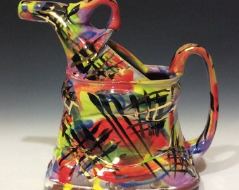 Rainbow of gold watering can